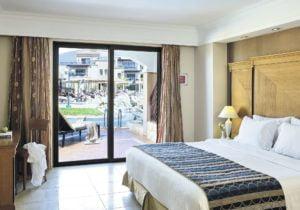 TUI SENSATORI Resort Atlantica Caldera Palace bedroom with swim up pool