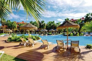 Hotel Pestana Porto Santo pool with sun chairs and palm trees