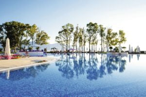 TUI BLUE Kerkyra Golf Outdoor pool lined with palmtrees